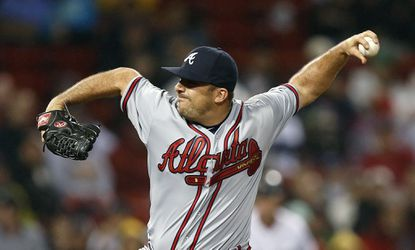 Atlanta Braves' Dana Eveland pitches during the seventh inning against the Boston Red Sox in Boston, Monday, June 15, 2015.