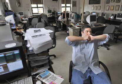 Adi Joseph, 21, a journalism major at the University of Maryland, sits in the newsroom of The Diamondback.