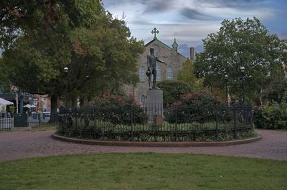 Surrounded by iron fencing, a statue of Capt. John O'Donnell (1749-1805) stands in the middle of O'Donnell Square, nestled in the center of the commercial district of Canton. (Karl Merton Ferron/Baltimore Sun Staff)