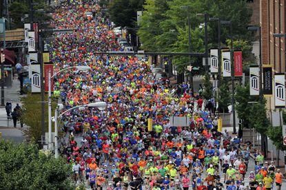 Runners begin the Baltimore Running Festival on Paca Street.