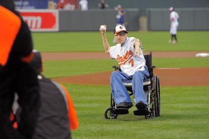 """Charlie """"Zillbilly"""" Zill, who had been known as the """"country boy"""" usher that used a fake fiddle during the seventh inning stretch, gets the honor of throwing out the first pitch before the game against the Tampa Bay Rays at Oriole Park at Camden Yards. Charlie is battling stage 4 lung cancer."""