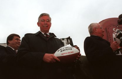 "At the Inner Harbor, Gov. Parris Glendening was the recipient of one of three ""game"" balls that were given out by the Ravens after the team's name was announced March 29, 1996."
