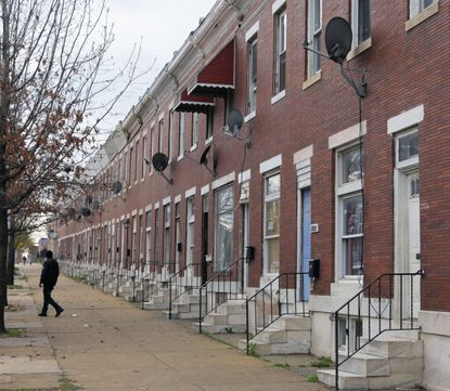 A new study says providing free lawyers to Baltimore tenants facing eviction can save tens of millions of dollars. A block of rowhouses is shown on April 1, 2020, at Wilkens Avenue and Catherine Street.