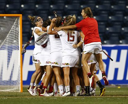 """A """"shock to the system,"""" national player of the year Taylor Cummings called the loss to Ohio State, which ended a 27-game winning streak for the Maryland women's lacrosse team. If Maryland was supposed to run roughshod over the Big Ten in any sport, it was probably lacrosse. Instead, the mighty Terps, hyped as perhaps the best team in the sport's history, didn't even make the final of their conference tournament. Fortunately, Cummings and her teammates still had time to write a tale of rapid redemption in the NCAA tournament. The Terps rolled to the final, where they had to stage another rally, from a three-goal halftime deficit, against North Carolina, the team that had knocked them off in the 2013 championship game. Led by Cummings and freshman Megan Whittle, they pulled out a 9-8 victory to earn their second straight national title and the program's 13th overall. Cummings (McDonogh), a junior midfielder, also picked up her second consecutive Tewaaraton Award as the nation's top player."""