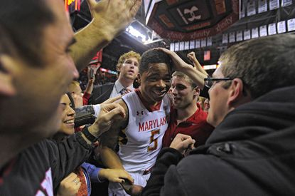 Nick Faust is congratulated by fans after Maryland upsets second-ranked Duke Saturday night.