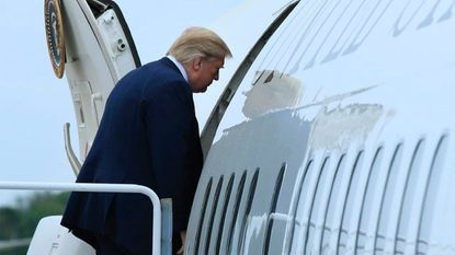 President Trump boards Air Force One on Saturday at Andrews Air Force Base.