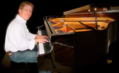 Matthew Shuman, of Westminster, is pictured playing one of his original music pieces on the piano.