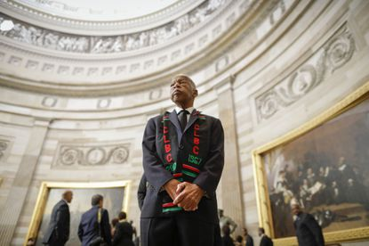 The late Rep. John Lewis and other members of the Congressional Black Caucus waited to enter as a group to attend the memorial services for Rep. Elijah Cummings at the U.S. Capitol in Washington last October.