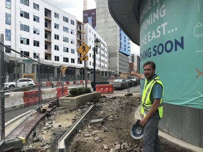 Nick Over, VP of Development at RPAI, gives a hard hat tour of development at Circle East in Towson.