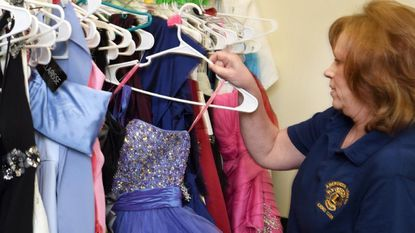 Sandy Pierce, Chairman of Cinderella's Closet, sorts through a few of the hundreds of gowns for the upcoming Cinderella's Closet event at the Comfort Inn Suites in Aberdeen Friday and Saturday March 2-3 sponsered by the Aberdeen Lioness Lions Club.
