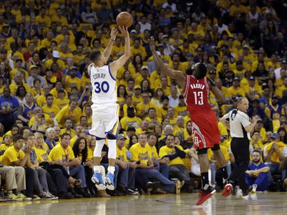 Golden State Warriors' Stephen Curry (30) makes a 3-point basket over Houston Rockets' James Harden (13) during the first half in Game 1 of a first-round NBA basketball playoff series Saturday, April 16, 2016, in Oakland, Calif.