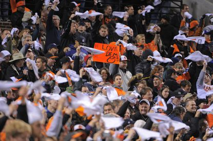 Fans greet the Orioles as they take the field for the start of Game 2 against the Yankees in the American League Division Series at Camden Yards.