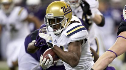UCLA running back Paul Perkins runs with the ball during the first half of a win over Washington on Nov. 8.