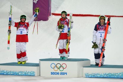 From left to right, silver medalist Chloe Dufour-Lapointe of Canada, gold medalist Justine Dufour-Lapointe of Canada and bronze medalist Hannah Kearney of the United States.