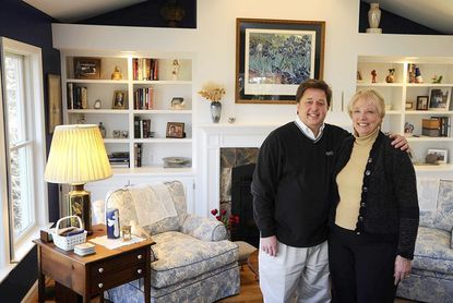 Scott Markle and his wife Corynne Courpas stand in the living room of their dream home.