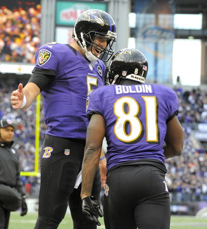 Joe Flacco and Anquan Boldin celebrate their fourth-quarter touchdown against the Colts.