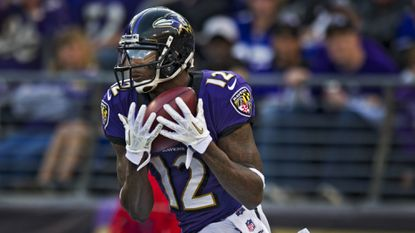 Jacoby Jones catches a kickoff from Shane Lechler before running it 105 yards for a touchdown against the Raiders to close the scoring in the Ravens' 55-20 victory Nov. 11, 2012. Jones returned four kickoffs for TDs in the regular season during his three years with the team.