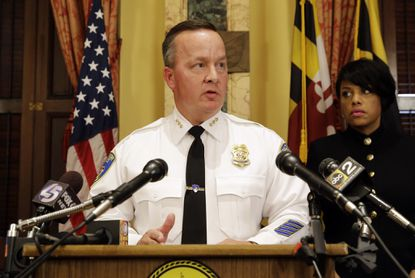 Interim Baltimore Police Commissioner Kevin Davis speaks alongside Mayor Stephanie Rawlings-Blake at a news conference on Wednesday.