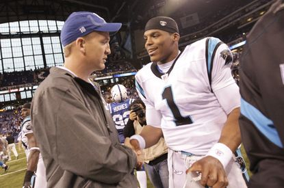 In this Nov. 27, 2011, file photo, injured Indianapolis Colts quarterback Peyton Manning meets with Carolina Panthers quarterback Cam Newton after an NFL football game in Indianapolis.
