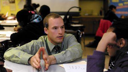 Justin Garritt, a math teacher at Beechfield Elementary School, teaches a sixth grade math class.