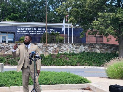 Malik Z. Shabazz, founder and National President of Black Lawyers for Justice, speaks outside the Howard County Police Headquarters.