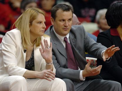 Former Maryland assistant and current Louisville coach Jeff Walz, right, talks with Terps head coach Brenda Frese during a 2007 game.