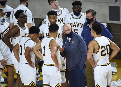 Navy's Ed DeChellis, shown talking to his Navy players during a timeout in the Army game earlier this season, has been named Patriot League Coach of the Year for the first time in his 10-year tenure.