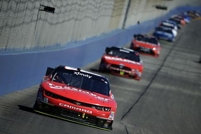 NASCAR driver Kevin Harvick leads the pack in the Xfinity Series Drive4Clots.com 300 at Auto Club Speedway on Saturday in Fontana.
