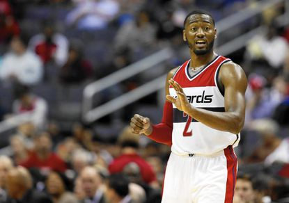 Washington Wizards guard John Wall (2) directs players in the second half of a pre-season NBA basketball game against the Charlotte Hornets, Friday, Oct. 17, 2014 in Washington. The Hornets won 96-86. (AP Photo/Alex Brandon) ** Usable by LA, DC, CGT and CCT Only **
