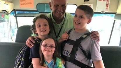 """Mr. Ted"" Quatman, the driver of Bus 327 to Darlington Elementary School, stands with students, from left, Albert Ball, Anna Sadowski and Alex Murphy."