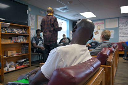 Men participate during morning meeting at Gaudenzia's addiction treatment center Thu., October 22, 2020. (Karl Merton Ferron / Baltimore Sun Staff)