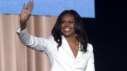 Former first lady and author Michelle Obama appears onstage at Becoming: An Intimate Conversation with Michelle Obama at the Forum in Inglewood, Calif., on Nov. 15.