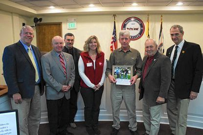 Stephen Lenker, second from right, of Catonsville, accepts the Big Fish award from Carroll County officials. From left are Recreation and Parks Director Jeff Degitz, Commissioner Steve Wantz, Commissioner Richard Rothschild, Piney Run Superintendent Sandy Buterbaugh, Commissioner Richard Weaver and Commissioner Dennis Frazier.
