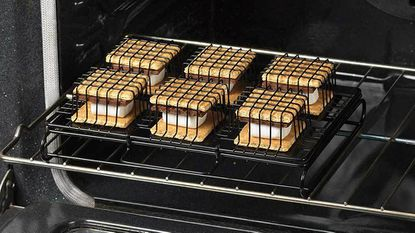For another layer of gooey goodness, slather the top of a cooked s'more with hazelnut spread, peanut butter, or marshmallow cream.