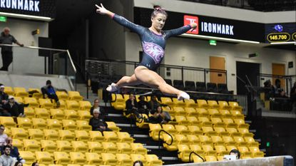 Emerson Hurst will represent the Towson gymnastics team in the balance beam event at the NCAA Ann Arbor Regionals on Friday night. The freshman is also a cousin of Ravens tight end Hayden Hurst.