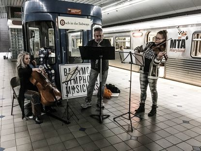 (Left to right) Cellist Kristin Ostling, oboist Michael Lisicky and violinist Holly Jenkins perform in the Baltimore subway as part of Bach in the Subways 2018.
