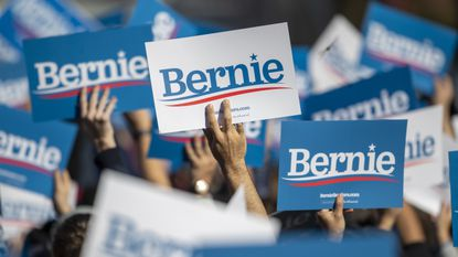 Supporters hold up Bernie signs during a campaign rally for Democratic presidential candidate Sen. Bernie Sanders, I-Vt., on Saturday, Oct. 19, 2019 in New York.