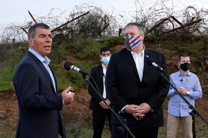 Israeli Foreign Minister Gabi Ashkenazi (L) speaks alongside U.S. Secretary of State Mike Pompeo following a security briefing on Mount Bental in the Israeli-annexed Golan Heights, near Merom Golan on the border with Syria, on November 19, 2020.