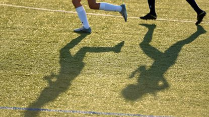 Players' shadows are seen on the turf field during a girls soccer game at Gerstell Academy on Sept. 4, 2018