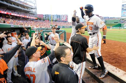 Adam Jones, right, celebrates with his teammates after hitting a two-run homer in the third inning that gave the Orioles a 4-0 lead over the Nationals.