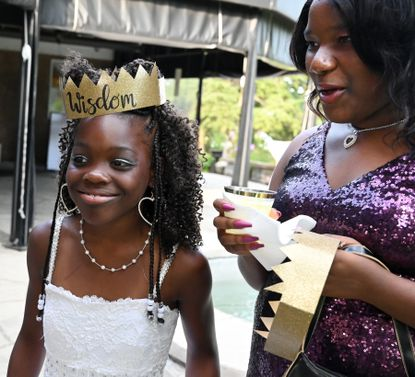 Wisdom Lightner, left, and Tahlia Cottman chat with some friends as they wait for dinner to be served during the Extreme Family Outreach Youth Leadership program Royal Ball Thursday, July 22, 2021 at Rockfield Manor.