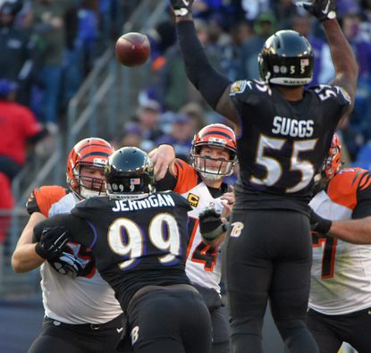 Ravens outside linebacker Terrell Suggs leaps to knock down pass by Cincinnati Bengals quarterback Andy Dalton. The Bengals have won six of the last seven games against the Ravens.