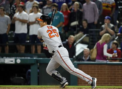 Orioles' Hyun Soo Kim (25) of South Korea follows through on single to right off a pitch from Texas Rangers' Shawn Tolleson in the ninth inning of a baseball game, Thursday, April 14, 2016, in Arlington, Texas.