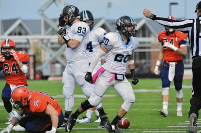 Johns Hopkins' Dan Johnson, a Westminster graduate, is shown celebrating a play against Gettysburg in 2015. Johnson is leading the Blue Jays into the NCAA playoffs Saturday. The defensive back has 57 tackles for the Blue Jays this season.