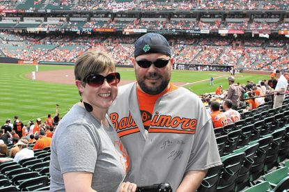 Paul Lauer and his wife Lauren are avid Baltimore Orioles fans. On Aug. 23, Lauer threw out the first pitch before the Orioles' 4-3 12-inning loss to the visiting Minnesota Twins