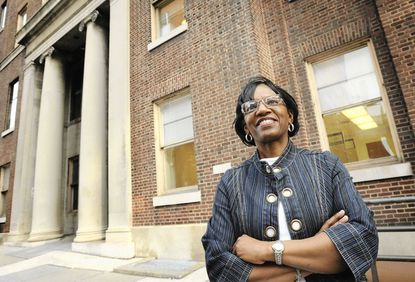 Patrice Henry, a patient advocate/community program coordinator for the Moore Clinic at Johns Hopkins Hospital, also was diagnosed with HIV in 1995. She's pictured outside the Carnegie Building at Johns Hopkins Hospital, which houses the clinic.