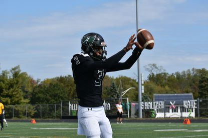 Atholton quarterback Ethan Brown warms up before the Raiders' 56-14 win over Mt. Hebron on Saturday, Oct. 12.