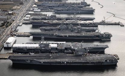 Aircraft carriers USS Dwight D. Eisenhower (CVN 69), USS George H.W. Bush (CVN 77), USS Enterprise (CVN 65), USS Harry S. Truman (CVN 75), and USS Abraham Lincoln (CVN 72) are in port at Naval Station Norfolk, Virginia, in this December 20, 2012 handout photo courtesy of the U.S. Navy.