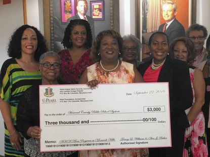 AKA Sorority members Front (l to r) Joyce Stanley, Tracey Williams (President), Melody Johnson Morales (Vice President) Back row(l to r) Dr. Kimetta Hairston, Andrea Moore Evans (Pearl Foundation, Inc. Vice President), Marie Gaines, Dianne Oliver, Lenora Booth, and Jean Lewis