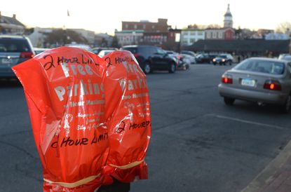 Parking meters in Annapolis are covered up, as free parking is offered for the holidays earlier this year.